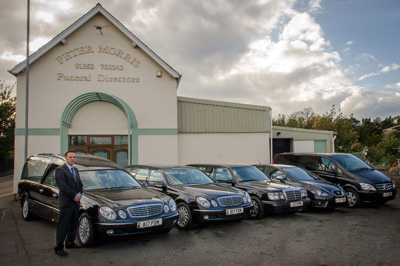 Peter Morris and the fleet of funeral cars